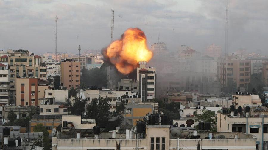 Rockets launched from Lebanon and Israel respond with artillery