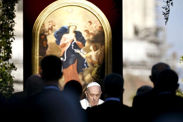 Pope Francis in front of a copy of the painting