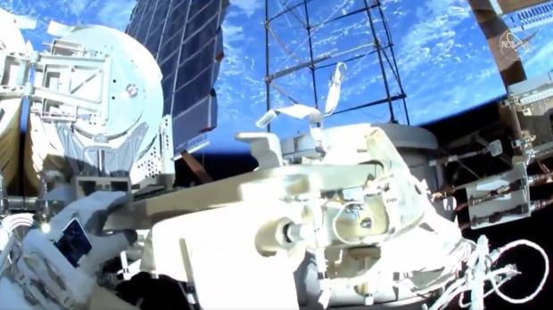 Astronauts on a spacewalk run the work of solar panels
