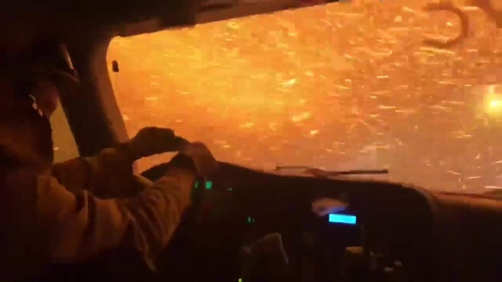 Video of a fire truck burning in the western United States passing by a very fierce fire