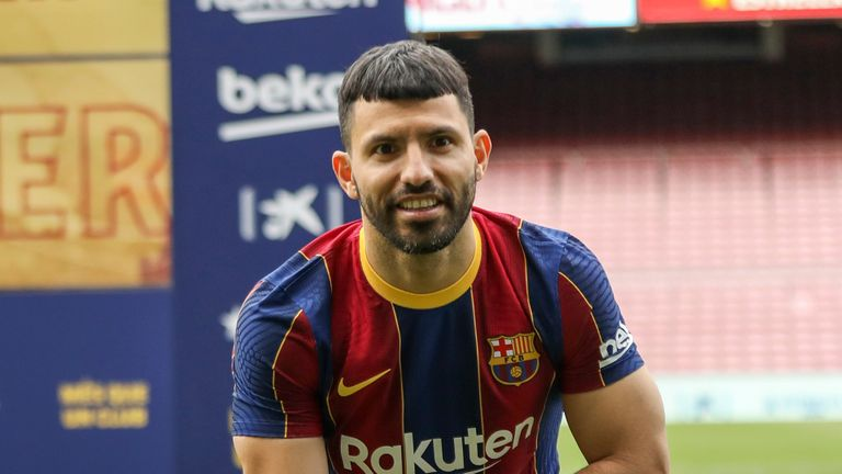 Argentine striker Sergio Con & # 39;  Aguero poses to the media during his official presentation after signing with FC Barcelona in Barcelona, Spain, on Monday, May.  31, 2021